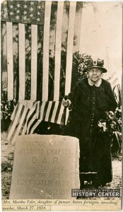 Martha Tyler unveils Fort Gatlin marker erected by the Orlando chapter of the Daughters of the American Revolution.